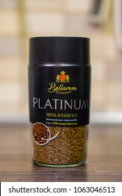 Poznan, Poland - March 27, 2018: Bellarom Platinum instant coffee mixed with grained coffee in a glass jar on wooden table. Brand belongs to Lidl.