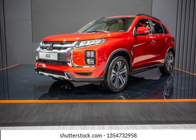 Poznan, Poland, March 28, 2019: metallic red Mitsubishi ASX at Poznan International Motor Show, compact crossover SUV produced by Japanese automaker Mitsubishi Motors