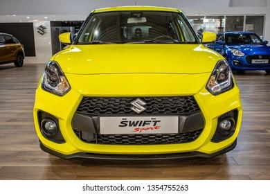 Poznan, Poland, March 28, 2019: metallic yellow Suzuki New Swift Sport at Poznan International Motor Show, Fourth generation, subcompact car B segment produced by Japanese manufacturer Suzuki