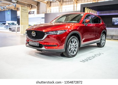 Poznan, Poland, March 28, 2019: metallic red Mazda All-new CX-5 AWD at Poznan International Motor Show, crossover SUV manufactured in Japan by Mazda