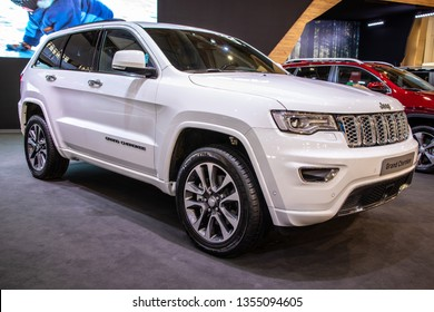 Poznan, Poland, March 28, 2019: metallic white Jeep Grand Cherokee 4x4 at Poznan International Motor Show, Mid-size SUVs produced by the American manufacturer Jeep