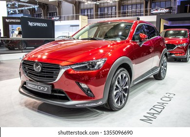 Poznan, Poland, March 28, 2019: metallic red Mazda CX-3 AWD Skyactiv Technology at Poznan International Motor Show, subcompact crossover SUV manufactured in Japan by Mazda