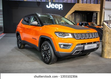 Poznan, Poland, March 28, 2019: metallic orange Jeep Compass 4x4 Trail Hawk compact crossover SUV at Poznan International Motor Show, Jeep is brand of American automobiles