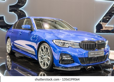 Poznan, Poland, March 28, 2019: metallic blue all new BMW 3 Series Sedan Limousine Berline 330i at Poznan International Motor Show, Seventh generation, G20, manufactured and marketed by BMW