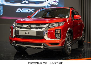 Poznan, Poland, March 28, 2019: metallic red Mitsubishi ASX at Poznan International Motor Show, fourth facelift, compact crossover SUV produced by Japanese automaker Mitsubishi Motors