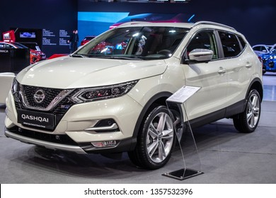 Poznan, Poland, March 28, 2019: metallic white Nissan Qashqai at Poznan International Motor Show, Second generation, J11, compact crossover SUV produced by Japanese car manufacturer Nissan since 2006