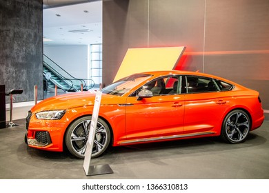 Poznan, Poland, March 28, 2019: metallic red Audi RS 5 Sportback at Poznan International Motor Show, Second generation, MLB Platform, EA839 engine, RS5, compact executive car produced by Audi