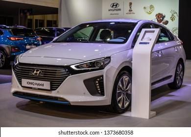 Poznan, Poland, March 28, 2019: white Hyundai IONIQ hybrid at Poznan International Motor Show electric eco friendly car produced by South Korean automotive manufacturer Hyundai
