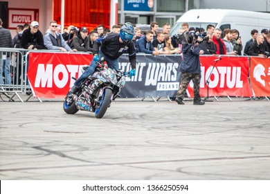 Poznan, Poland, March 29, 2019, Motorcycle Stunt shows - extreme emotions, Stunt motorcycle rider performing with acrobatic skills at Poznan International Motor Show,