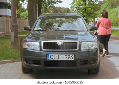 Poznan, Poland - May 1, 2018: Front of a parked Skoda car with Polish license plate. Vintage style colors.