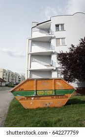 POZNAN, POLAND - MAY 16, 2017: Eko-Tom waste container in front of a apartment block