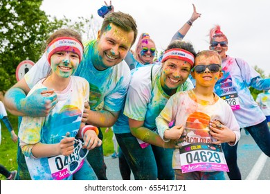 Poznan, Poland - May 20, 2017: Happy family participating in the Color Run. The Color Run is a worldwide hosted 5K fun race