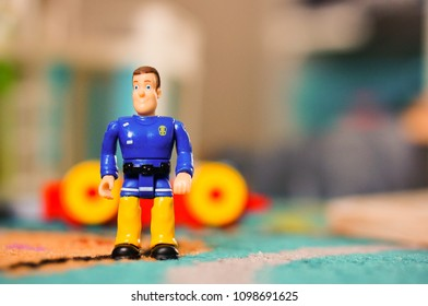 Poznan, Poland - May 25, 2018: Fireman Sam toy figure without helm in soft focus background