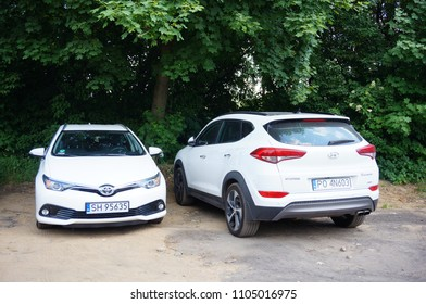 Poznan, Poland - May 27, 2018: Parked Hyundai and Toyota car on a parking lot during the Kindernalia event on a warm day