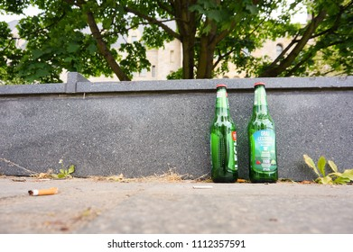 Poznan, Poland - May 30, 2018: Two empty Lech beer bottles standing on a pavement in the city center
