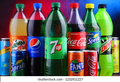 POZNAN, POLAND - NOV 16, 2018: Bottles and cans of global soft drink brands including products of Coca Cola Company and Pepsico