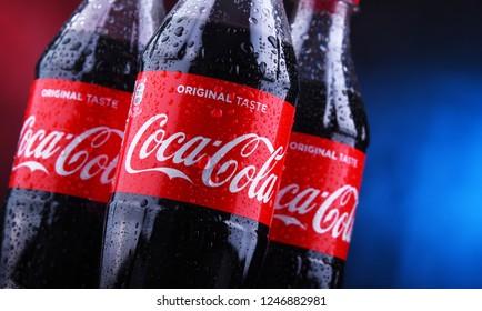 POZNAN, POLAND - NOV 29, 2018: Plastic bottles of Coca-Cola, a carbonated soft drink manufactured by The Coca-Cola Company headquartered in Atlanta, Georgia, USA
