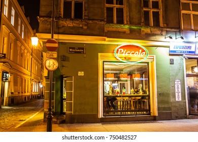 Poznan, Poland, November 04, 2017: old Market Square at night, Spaghetti Bar Piccolo on the corner of Wroclawska and Golebia Streets