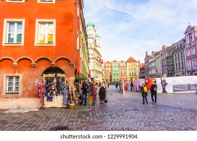Poznan, Poland - November 12, 2018: Colorful building with gift shop and people on the old city square.