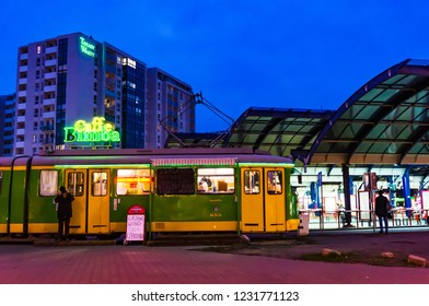 Poznan, Poland - November 16, 2018: Tram with Caffe Bimba on the Rataje bus station by night.