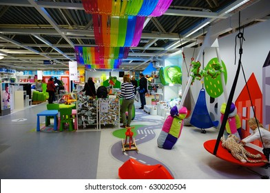 POZNAN, POLAND - NOVEMBER 24, 2013: People at a toy department in a Ikea store
