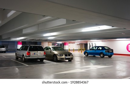 POZNAN, POLAND - Oct 26, 2013: Parked cars in the Posnania shopping mall indoor parking garage