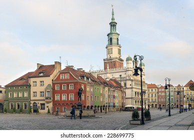 POZNAN, POLAND - OCTOBER 24, 2014: Colorful ancient tenement houses and ancient Town Hall in Old Market Square, Poznan, Poland