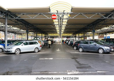 POZNAN, POLAND - OCTOBER 26, 2013: Many cars at a parking lot of a Selgros store