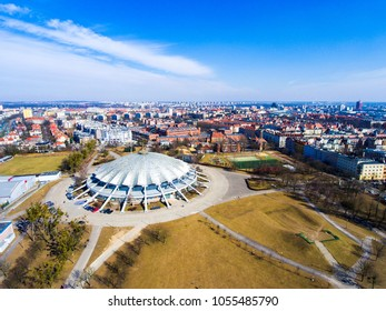 Poznan, Poland on March 20, 2018. Arena sports hall on a beautiful sunny day, aerial view.