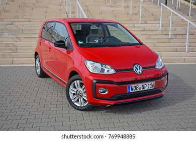 Poznan, Poland - September, 23, 2016: Volkswagen Up! parked next to stairs.