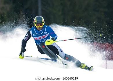POZZA DI FASSA, ITALY - DECEMBER 30: Unidentified participant of ski race performs at Italian Slalom Championship on December 30, 2012, Pozza di Fassa, Italy