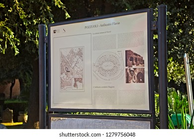 POZZUOLI, ITALY - NOVEMBER 03, 2015: Information plate near of the ruins of the Flavian Amphitheater in Pozzuoli. Is the third largest Roman amphitheater in Italy.