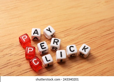 PPC text , pay per click  cubes on wooden background