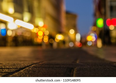 Ppedestrian road in the night city with a bright bokeh on the background. 