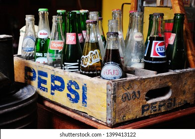 Prachin Buri, Thailand, Mar 27, 2010:Collection of vintage soft drinks that have not yet opened. These bottles with 7up, Pepsi, Royal Crown, Suncrest, Union and Howd in wooden crates.