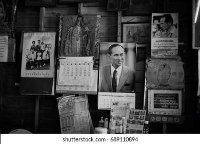PRACHINBURI, THAILAND- Jul 23, 2017 : Full of beloved His Majesty King Bhumibol Adulyadej; King RAMA IX, photos on the local cafe wall in black and white