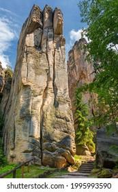 Prachov rocks (Prachovske skaly) in Cesky Raj region, Czech Republic. Sandstone rock formation in vibrant forest. Prachov Rocks, Czech: Prachovske skaly, in Bohemian Paradise, Czech Republic. - Shutterstock ID 1995993590