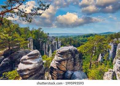 Prachov rocks (Prachovske skaly) in Cesky Raj region, Czech Republic. Sandstone rock formation in vibrant forest. Prachov Rocks, Czech: Prachovske skaly, in Bohemian Paradise, Czech Republic. - Shutterstock ID 1995993593