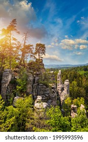 Prachov rocks (Prachovske skaly) in Cesky Raj region, Czech Republic. Sandstone rock formation in vibrant forest. Prachov Rocks, Czech: Prachovske skaly, in Bohemian Paradise, Czech Republic. - Shutterstock ID 1995993596