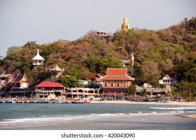 PRACHUAB KHIRI KHAN,THAILAND-MAY 7,2016 : Scenic view of outdoor sitting golden Phra Putha SakrayaSin Maharat Buddha statue on top of hill of Khao Tao temple from the Khao Tao Beach,Thailand.