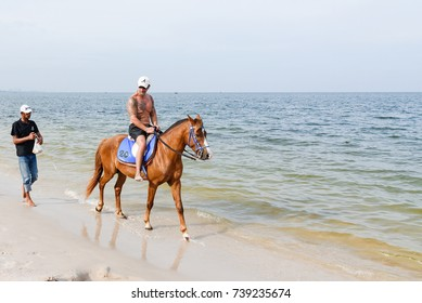 Prachuab Khirikhan, Thailand - October, 13, 2017 : Unidentified name people riding a horse at Huahin beach of Thailand.