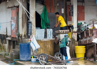 Prachuab Khirikhan, Thailand - October, 13, 2017 : Unidentified name Workers transport ice block in the fish market at Hua Hin Prachuab Khirikhan,Thailand