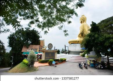 PRACHUAP KHIRI KHAN, THAILAND - JANUARY 30 : Thai people travelers visit and praying Buddha statue at Wat Phra Mahathat chedi Pakdee Prakard on January 30, 2018 in Prachuap Khiri Khan, Thailand.