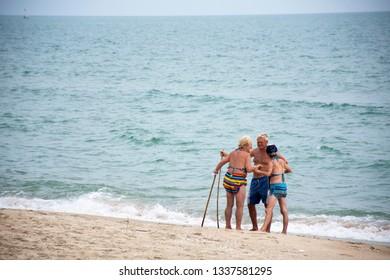 PRACHUAP KHIRI KHAN, THAILAND - JANUARY 30 : Thai people and foreigner travelers walking visited and resting at Ban Krut Beach on January 30, 2018 in Prachuap Khiri Khan, Thailand.