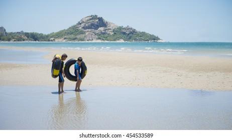Prachuap Khiri Khan, Thailand - Jul 17 2016 : An Unidentified 2 Brother walking along a beach at Suan Son Pradipat Beach Hua Hin Prachuap Khiri Khan Thailand.