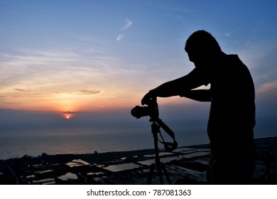 PRACHUAP KHIRI KHAN,THAILAND - JANURAY 2, 2018:Silhouette of photographer is taking picture of the sky and sea at sunrise on public attractions Khao Daeng Viewpoint  at Khao Sam Roi Yot Nation Park