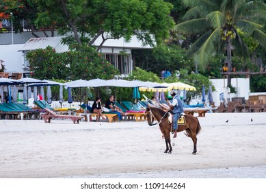 Prachuap Khiri Khan,Thailand - June, 02, 2018 : Unidentified name people riding a horse in sunset time at Huahin beach of Prachuap Khiri Khan,Thailand