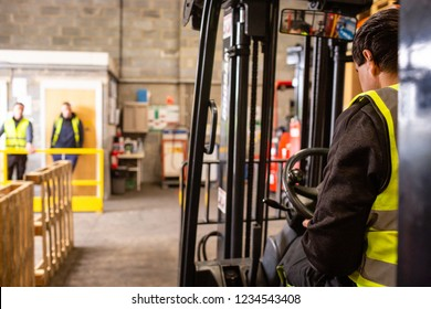 Practical forklift training course. Industrial background.
