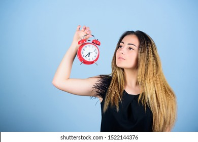 Practice of advancing clocks. Daylight saving time. Change time zone. Pretty girl managing her time. Woman hold vintage alarm clock. Watch repair. Time management. Punctuality and discipline.