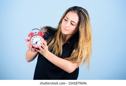Practice of advancing clocks. Daylight saving time. Change time zone. Watch repair. Time management. Punctuality and discipline. Pretty girl managing her time. Woman hold vintage alarm clock.